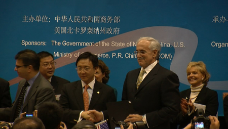 Dr. William Greenlee, president and CEO of The Hamner Institutes (second from right) shakes hands with Dr. Yang Yunsong, president and CEO of XY Group International in Beijing at a signing ceremony on Jan. 18 at the NC-China Trade and Investment Seminar in Research Triangle Park. Looking on is N.C. Gov. Bev Perdue (far right).