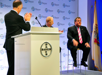 Phil Blake, Bayer Corp. president, applauds New Jersey Gov. Chris Christie (r.) at the October 2013 grand opening of Bayer HealthCare's newly consolidated 2,400-employee HQ in Whippany, N.J., in Hanover Township. Seated alongside Christie is Marijn Dekkers, chairman of the board for Bayer AG.
