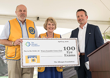 Allergan President & CEO Brent Saunders presents a donation of 100 eye exams to Waco Lions Club President Buck Rogers and Past President and Vision Screening Chair Louise Ann Powell.