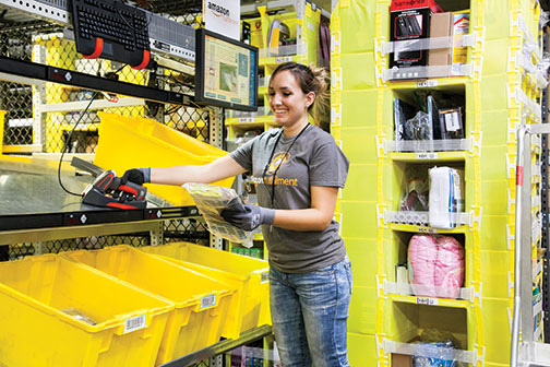 An employee at one of Amazon's 11 fulfillment centers in Kentucky completes an order.