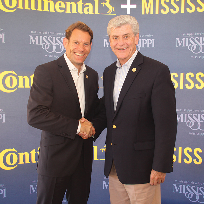 Gov. Phil Bryant welcomes Continental Tire's Nikolai Setzer to Mississippi.