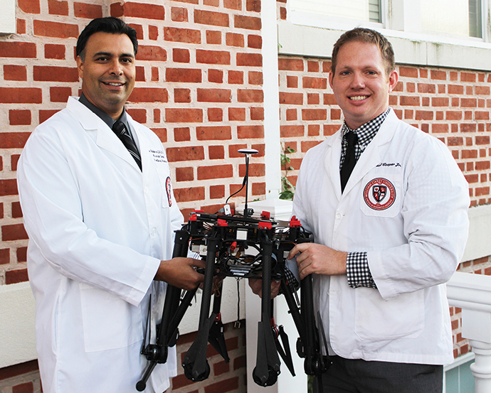 Dr. Italo Subbarao and medical student Guy Paul Cooper Jr. with the medical drone they developed.<br />