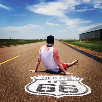 James Rollings poses for a photo along Route 66 while traveling the historic road through Oklahoma.