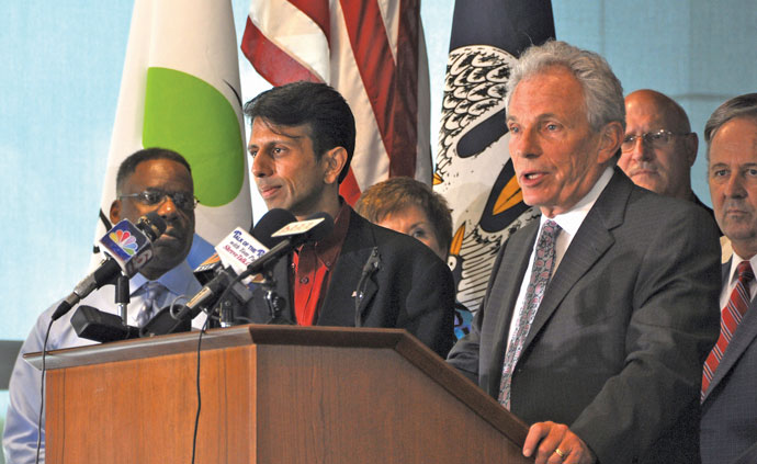 Ronpak founder Ron Sedley (right) is joined by Louisiana Gov. Bobby Jindal to announce the company's headquarters relocation to Shreveport-Bossier after setting up manufacturing there just last year.