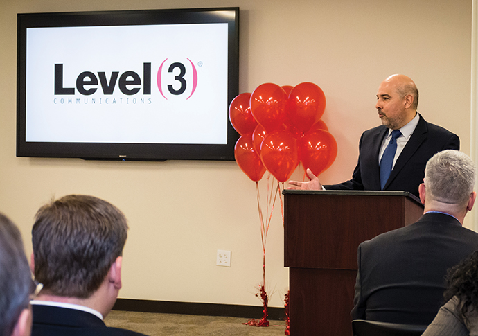 Jorge Magana of Level 3 Communications welcomes visitors to the official opening of the firm's new operations center in Gwinnett County, Ga., near Atlanta.