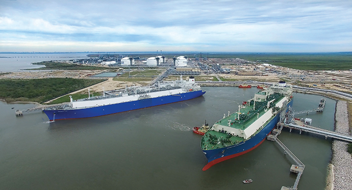 Two tankers take on liquefied natural gas at Cheniere Energy's ground-breaking LNG export terminal, built on 1,000 acres along the Texas-Louisiana border.