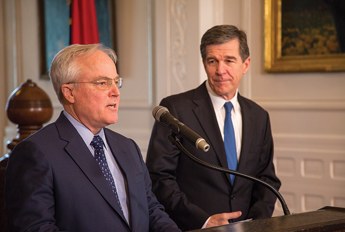 North Carolina Commerce Secretary Anthony M. Copeland (left) and Gov. Roy Cooper