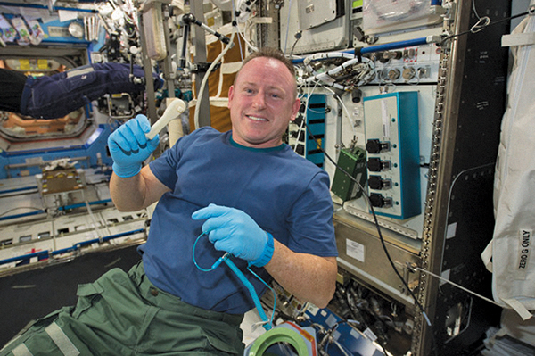 Astronaut Barry Wilmore and his new 3D-printed ratchet, courtesy of Made in Space's additive manufacturing facility on the International Space Station.