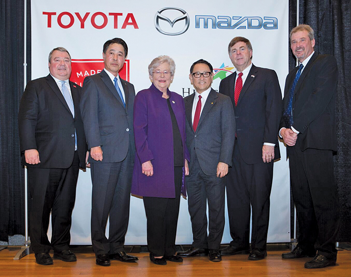 Pictured (l. to r.) at the announcement of Huntsville's $1.6-billion vehicle production plant are Alabama Commerce Secretary Greg Canfield, Mazda CEO Masamichi Kogai, Alabama Governor Kay Ivey, Toyota President Akio Toyoda, Huntsville Mayor Tommy Battle, and Limestone County Commission Chairman Mark Yarbrough.