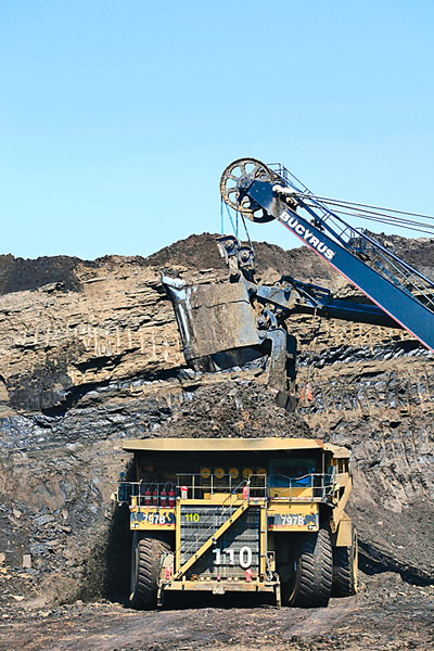 The 797B Caterpillar mining trucks used for the Athabasca oil sands project at