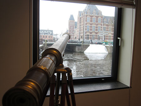 A telescope in the corner of an Appsterdam meeting space conjures the city's centuries-old reputation as a haven for searchers, as well as its historic role in the field of astronomy.