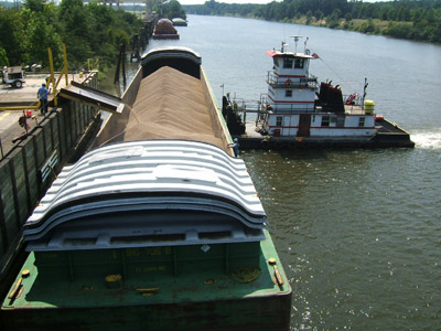 Enviva loads pellets onto a barge on the Tenn-Tom Waterway from its facility in Amory, Miss.