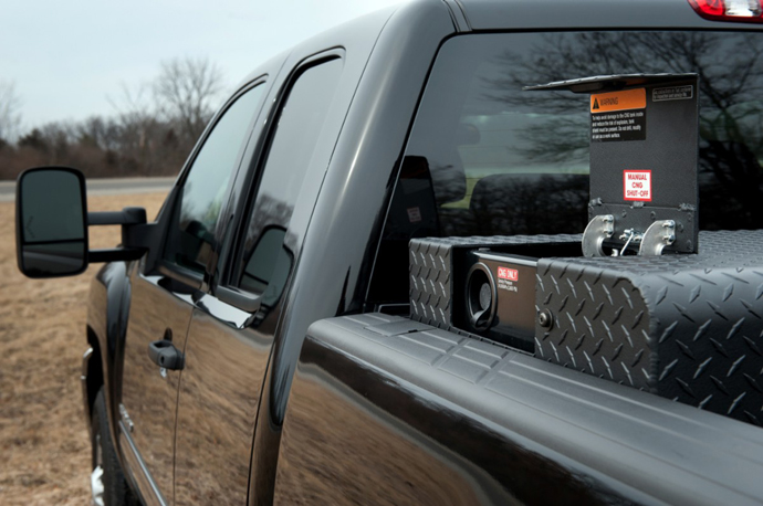 The 2013 bi-fuel Chevrolet Silverado HD includes a compressed natural gas (CNG) capable engine that GM says seamlessly transitions between CNG and gas fuel systems. The CNG and gasoline tanks have a combined range of 650 miles.