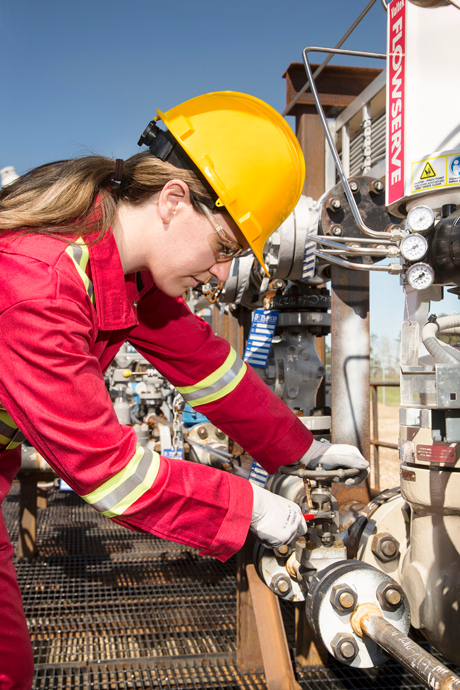 A Shell employee works in summer 2015 at a CO2 injection well that is part of the Quest Carbon Capture and Storage Project.